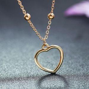 Classic Gold Hollow Heart Pendant Necklace
